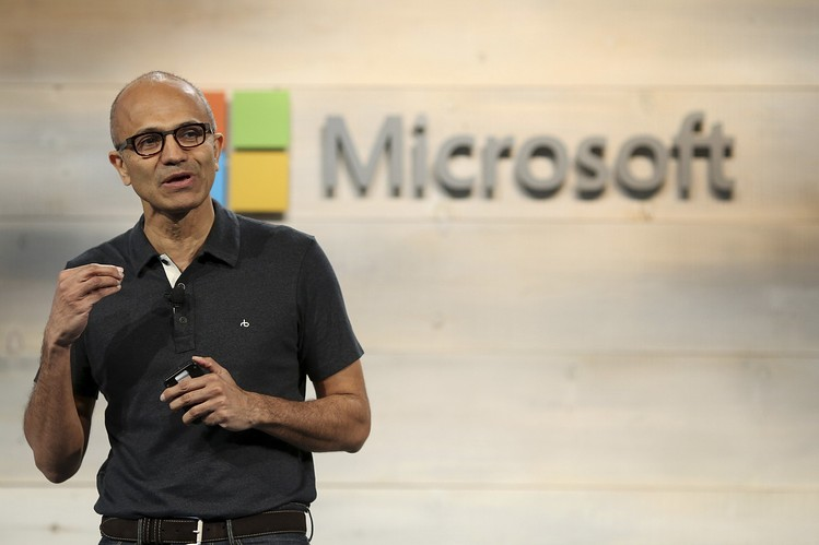 Microsoft shares were hit after the company forecast lower-than-expected earnings because of the strong U.S. dollar. Above, CEO Satya Nadella in October.