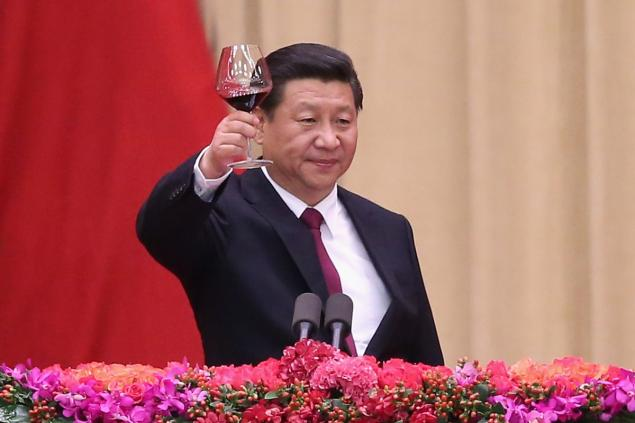 Chinese President Xi Jinping gives a toast during the National Day reception marking the 65th anniversary of the founding of the People's Republic of China